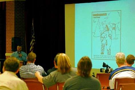 Robert Swain presents his drawings from Laughsquatch. Photo: Chris Buntenbah
