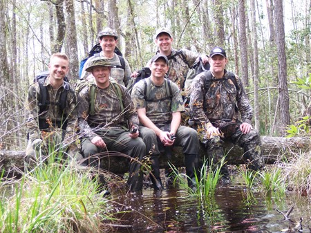 McAndrews, Colyer, Higgins, Mayes, Pinkerton and Helmer pose for a photo on a downed dry log in the swampy Area Y, March 2007.