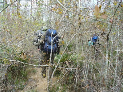 Brad McAndrews follows Ken Helmer and Alton Higgins as they attempt to bulldoze through dense thicket in Area Y, February 2007.