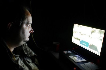 Mark McClurkan monitors the new surveillance system on a slow, quiet night. Photo by Rick Hayes.